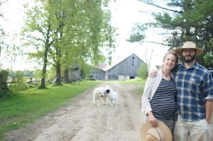 Photo of Mary, Brad and farm with dogs